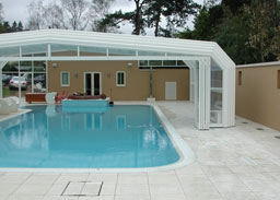 Swimming pool enclosures swimming pools for Retractable pool enclosures cost